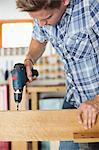 Man working in workshop Stock Photo - Premium Royalty-Free, Artist: Blend Images, Code: 6113-06753336