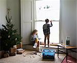 Children in living room with Christmas tree Stock Photo - Premium Royalty-Free, Artist: Westend61, Code: 6113-06753369