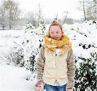 Girl smiling in snow Stock Photo - Premium Royalty-Freenull, Code: 6113-06753401