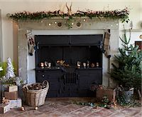 Fireplace decorated for Christmas Stock Photo - Premium Royalty-Freenull, Code: 6113-06753406
