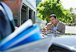 Business people talking at car Stock Photo - Premium Royalty-Free, Artist: Kevin Dodge, Code: 6113-06753426