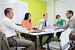 Business people talking in meeting Stock Photo - Premium Royalty-Free, Artist: Westend61, Code: 6113-06753483