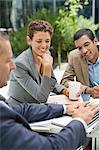 Business people talking in meeting outdoors Stock Photo - Premium Royalty-Free, Artist: Westend61, Code: 6113-06753537