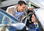 Businessmen talking in car Stock Photo - Premium Royalty-Free, Artist: Kevin Dodge, Code: 6113-06753576