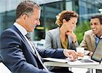 Business people talking outdoors Stock Photo - Premium Royalty-Free, Artist: Westend61, Code: 6113-06753579