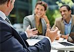 Business people talking in meeting Stock Photo - Premium Royalty-Free, Artist: Ikon Images, Code: 6113-06753591