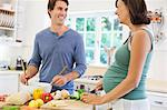 Couple cooking together in kitchen Stock Photo - Premium Royalty-Free, Artist: Blend Images, Code: 6113-06753687