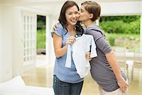 pregnant women kissing - Woman giving pregnant friend baby clothes Stock Photo - Premium Royalty-Freenull, Code: 6113-06753723
