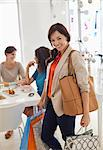 Woman shopping in store Stock Photo - Premium Royalty-Free, Artist: Blend Images, Code: 6113-06753735