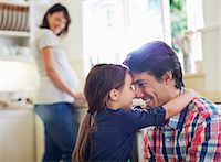 Father and daughter hugging in kitchen Stock Photo - Premium Royalty-Freenull, Code: 6113-06753747
