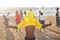 soccer player (male) - Boy celebrating with soccer jersey on his head in dirt field Stock Photo - Premium Royalty-Freenull, Code: 6113-06753765
