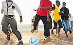 Boys playing soccer together in dirt field Stock Photo - Premium Royalty-Freenull, Code: 6113-06753824