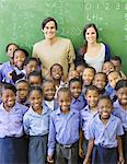 Students and teachers smiling in class Stock Photo - Premium Royalty-Freenull, Code: 6113-06753877