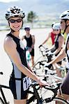 Cyclist smiling before race Stock Photo - Premium Royalty-Free, Artist: ableimages, Code: 6113-06753981