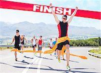 finish line - Runner crossing race finish line Stock Photo - Premium Royalty-Freenull, Code: 6113-06753987