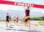 Runner crossing race finish line Stock Photo - Premium Royalty-Free, Artist: Aflo Sport, Code: 6113-06753987