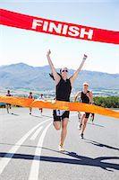 finish line - Runner crossing race finish line Stock Photo - Premium Royalty-Freenull, Code: 6113-06754004