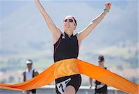 Runner crossing race finish line Stock Photo - Premium Royalty-Freenull, Code: 6113-06754062