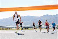 finish line - Runners crossing race finish line Stock Photo - Premium Royalty-Freenull, Code: 6113-06754084
