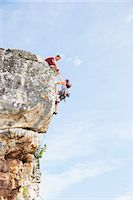 Climbers scaling steep rock face Stock Photo - Premium Royalty-Freenull, Code: 6113-06754103