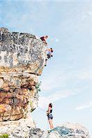 rock climber - Climbers scaling steep rock face Stock Photo - Premium Royalty-Freenull, Code: 6113-06754105