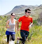 Couple running on dirt path Stock Photo - Premium Royalty-Free, Artist: ableimages, Code: 6113-06754131