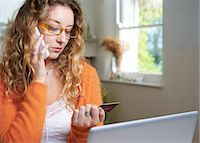 person on phone with credit card - Woman shopping on telephone Stock Photo - Premium Royalty-Freenull, Code: 6113-06754187