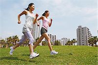 Friends Jogging On Grass Stock Photo - Premium Rights-Managednull, Code: 858-06756062