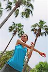 Woman Exercising Near Palm Trees Stock Photo - Premium Rights-Managed, Artist: Aflo Sport, Code: 858-06756107
