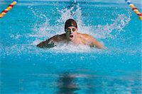 swimming pool water - Swimmer Doing The Butterfly Stroke In Pool Stock Photo - Premium Rights-Managednull, Code: 858-06756401