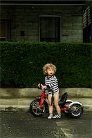 Boy with Bicycle on Neighbourhood Street Stock Photo - Premium Rights-Managednull, Code: 700-06758131