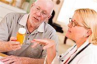 Doctor or Nurse Explaining Prescription Medicine to Attentive Senior Man. Stock Photo - Royalty-Freenull, Code: 400-06763252