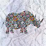 beautiful ornamental silhouette of rhinoceros on the textural background