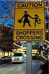 Sign near shopping mall reads: Caution Shoppers Crossing, Austin, Texas, USA