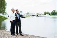 Businessmen Standing by River, Mannheim, Baden-Wurttemberg, Germany Stock Photo - Premium Royalty-Freenull, Code: 600-06773353