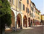 bicycles parked on cobblestone street, beside quaint buildings with window shutters, and archways, Modena, Italy Stock Photo - Premium Rights-Managed, Artist: Michael Mahovlich, Code: 700-06773312