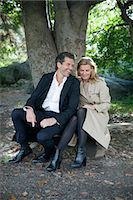 Smiling mature couple sitting Stock Photo - Premium Royalty-Freenull, Code: 6102-06777313