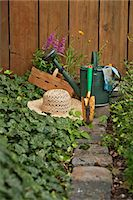 potted plant - Garden equipment, flowers and straw hat in the garden, Munich, Bavaria, Germany Stock Photo - Premium Royalty-Freenull, Code: 6115-06778642