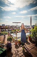 Young Woman On Balcony Holding Garden Rake, Munich, Bavaria, Germany, Europe Stock Photo - Premium Royalty-Freenull, Code: 6115-06778647