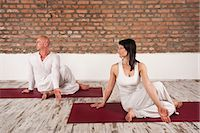 flexible (people or objects with physical bendability) - Couple Practising Yoga Stock Photo - Premium Royalty-Freenull, Code: 6115-06778904