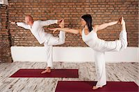 flexible (people or objects with physical bendability) - Couple In Yoga Pose Stock Photo - Premium Royalty-Freenull, Code: 6115-06778907