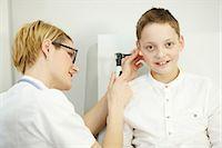 Female doctor examining boys ear, Osijek, Croatia Stock Photo - Premium Royalty-Freenull, Code: 6115-06778951
