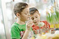 Two Boys Painting Eggs, Osijek, Croatia, Europe Stock Photo - Premium Royalty-Freenull, Code: 6115-06779034
