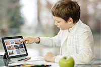 preteens fingering - Boy using digital tablet, Osijek, Croatia, Europe Stock Photo - Premium Royalty-Freenull, Code: 6115-06779067