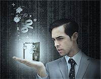 percentage symbol - Concentrated businessman holding a door Stock Photo - Premium Royalty-Freenull, Code: 6109-06781422