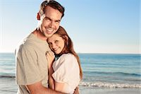 Cheerful couple relaxing on the beach during  summer Stock Photo - Premium Royalty-Freenull, Code: 6109-06781664