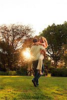 Man holding his girlfriend in a park Stock Photo - Premium Royalty-Freenull, Code: 6109-06781733