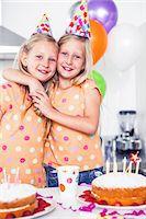Twins celebrating their birthday Stock Photo - Premium Royalty-Freenull, Code: 6109-06781754