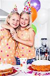Twins celebrating their birthday Stock Photo - Premium Royalty-Free, Artist: Beth Dixson, Code: 6109-06781754