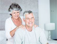 Woman giving a massage to her husband Stock Photo - Premium Royalty-Freenull, Code: 6109-06781882